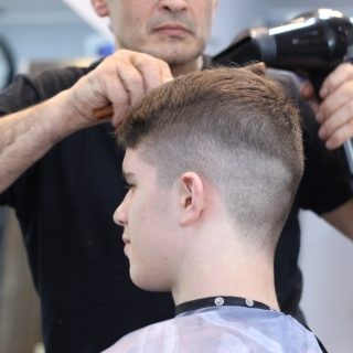 holič